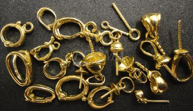 Contromaglie e portapietre in oro